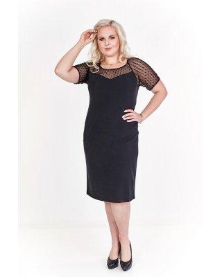 Dopasowana czarna sukienka...